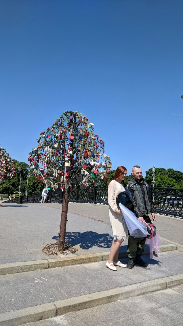 Newlywed bikers on the Bridge of Love in Moscow